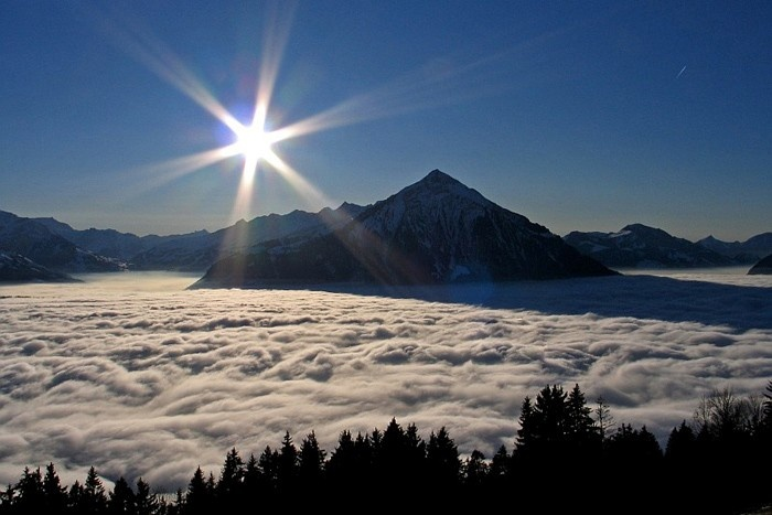 Enlargement: View of Beatenberg across the sea of high fog in the Bernese Alps